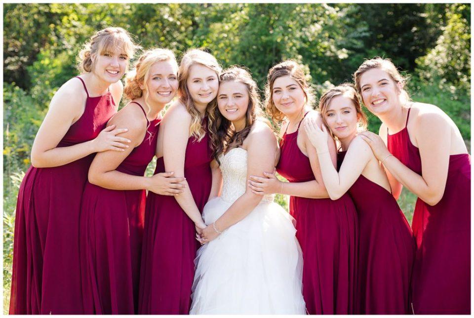 bride and bridesmaids hugging at cedar grove lodge