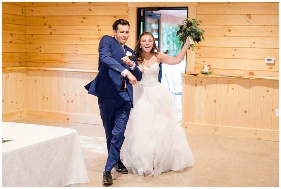 bride and groom dancing as they enter reception at cedar grove lodge