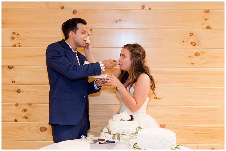 bride smashing cake in groom's face at cedar grove lodge