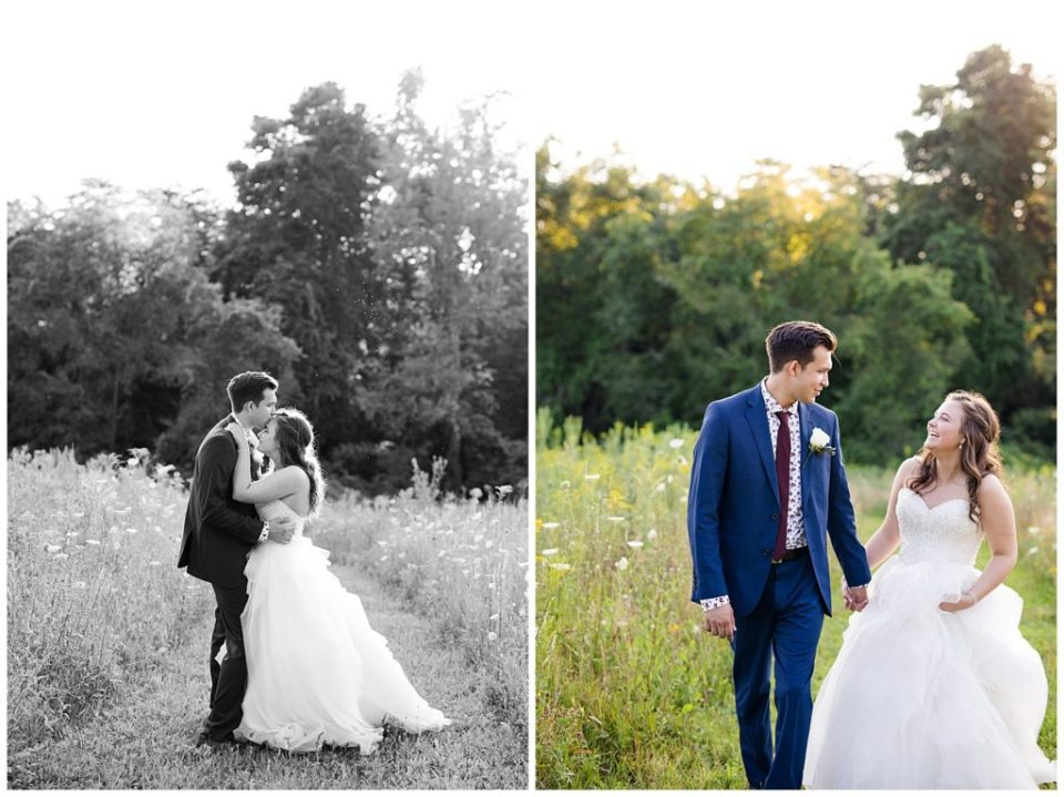 black and white image of groom kissing bride's forehead in field at cedar grove lodge