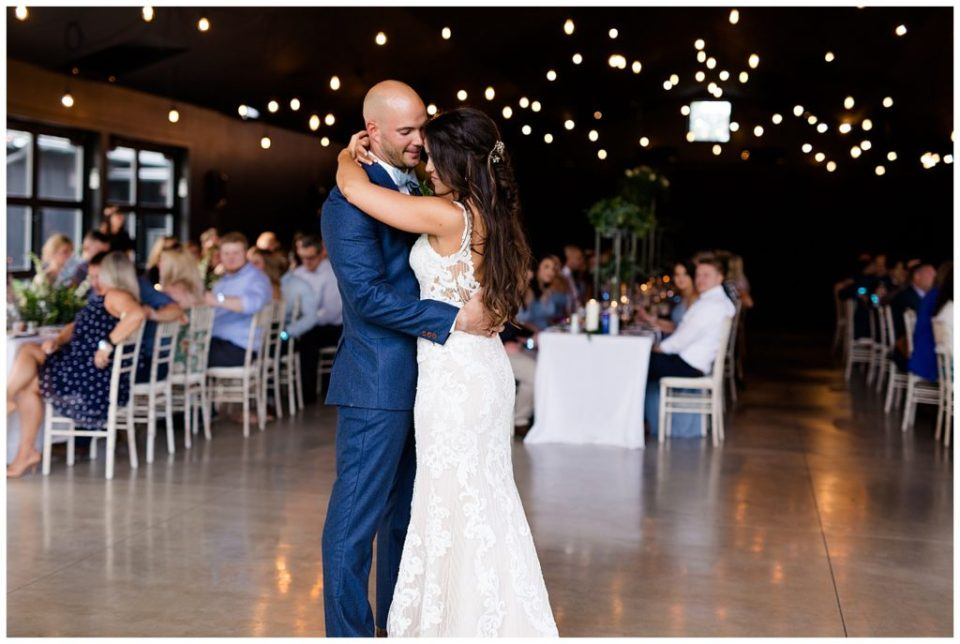 A photograph of the bride and groom romantically dancing their first dance at the wedding reception at the Oak Grove wedding venue by Columbus OH wedding photographer, Alayna Parker Photography