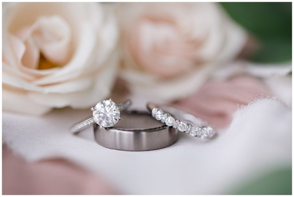 An image of a closeup of beautiful wedding rings and roses at Jorgensen Farms wedding venue by Alayna Parker  - Columbus Ohio wedding photographers