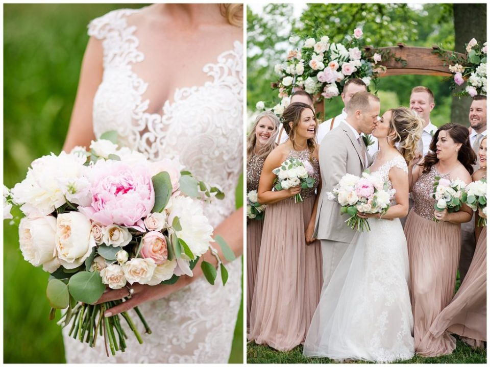 A photograph of a closeup view of the bride's bouqet, and a view of the bride and groom kissing, surrounded by their wedding party at Jorgensen Farms wedding venue by Alayna Parker Photography  - Columbus OH rustic wedding photography