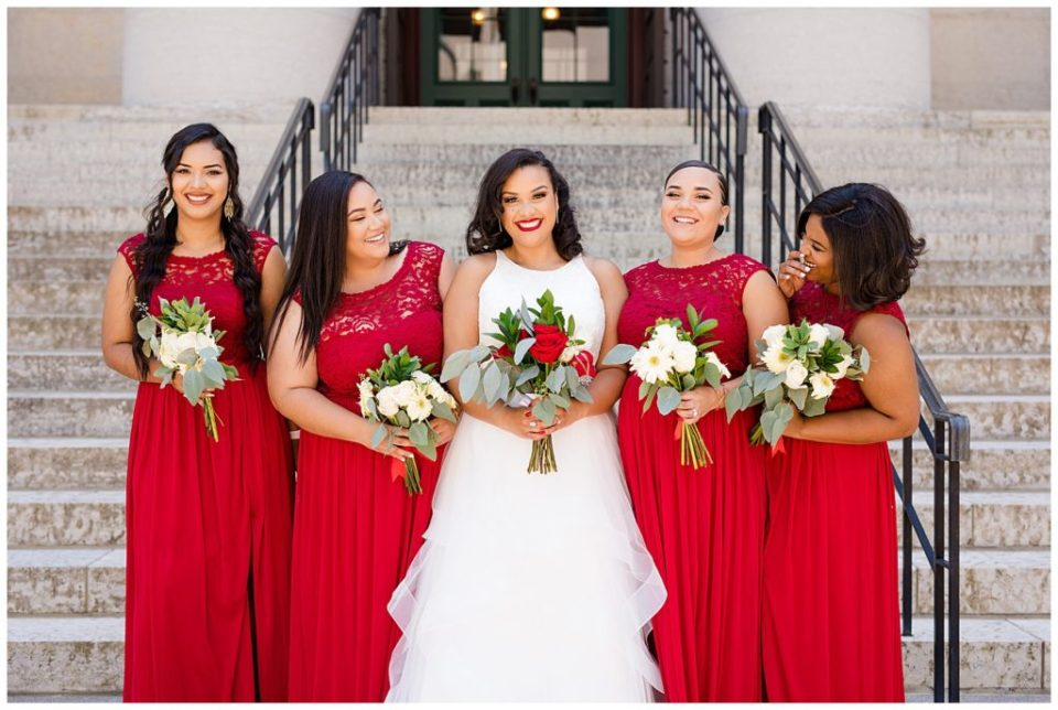 bride and bridesmaids laughing at ohio statehouse
