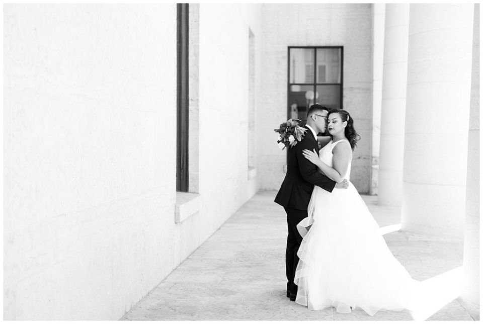 black and white image of bride and groom embracing at ohio statehouse