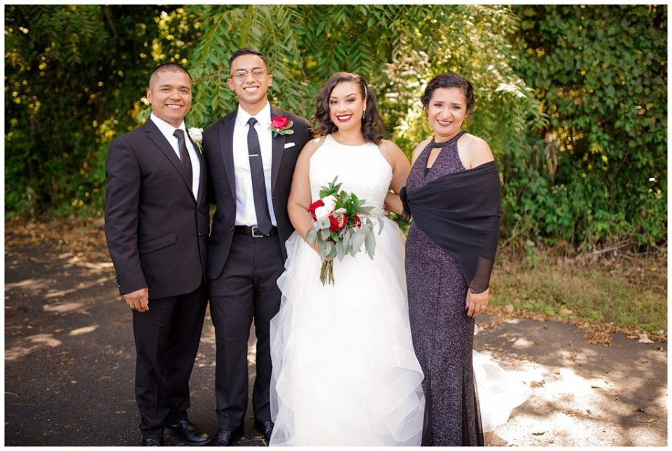 An image of the bride and groom with the groom's parents after the wedding by Columbus Ohio wedding photography specialist, Alayna Parker Photography