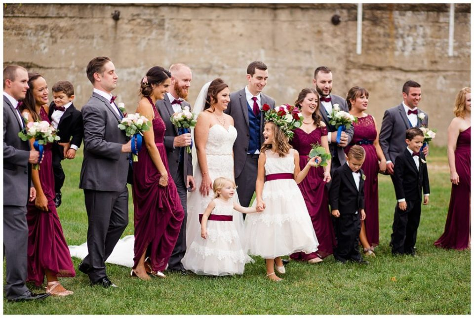 A picture of the wedding party relaxing and talking together outdoors after the wedding at a Station 67 Columbus OH wedding by Alayna Parker Photography
