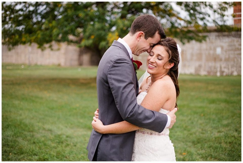 An image of the bride and groom smiling and holding each other tightly at a Station 67 Columbus  wedding by Alayna Parker Photography