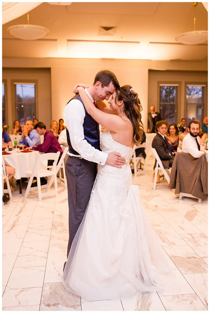 A picture of the bride and groom holding each other as they dance the first dance at their wedding reception at a Station 67 Columbus OH wedding by Alayna Parker Photography