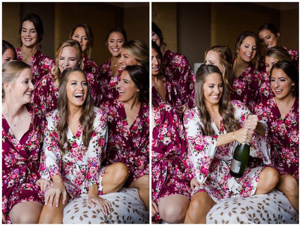 A picture of a bride and her bridesmaids laughing together in their matching robes before getting dressed for the wedding by Columbus  wedding photographer, Alayna Parker Photography