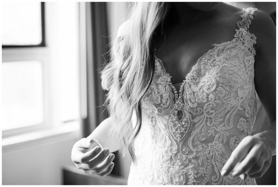 A photograph of a closeup black and white view of a bride in her dress, showing her hair and details of the dress by Columbus OH wedding photographer, Alayna Parker Photography