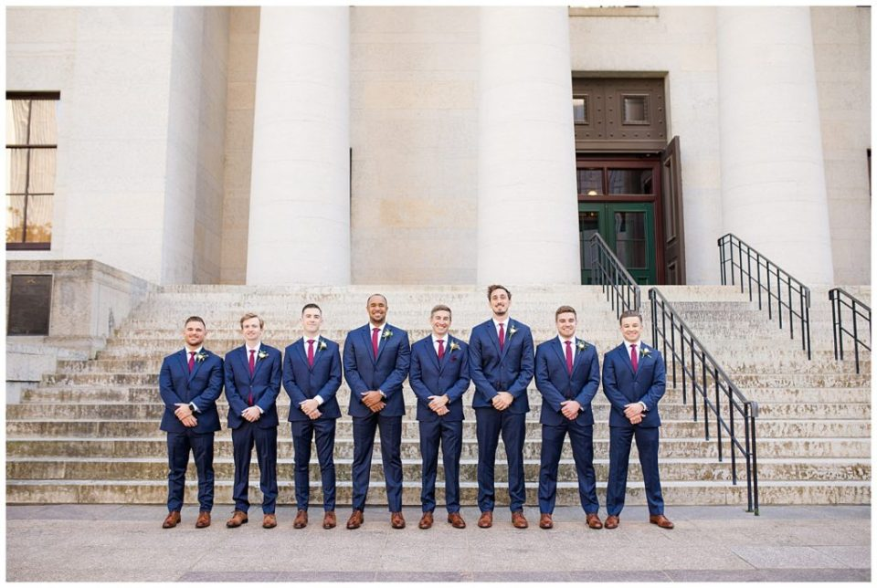 groom and groomsmen standing outside ohio statehouse