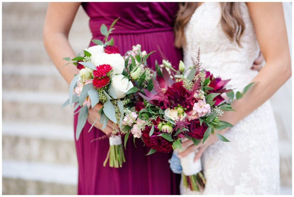close up of bride and a bridesmaid holding flowers