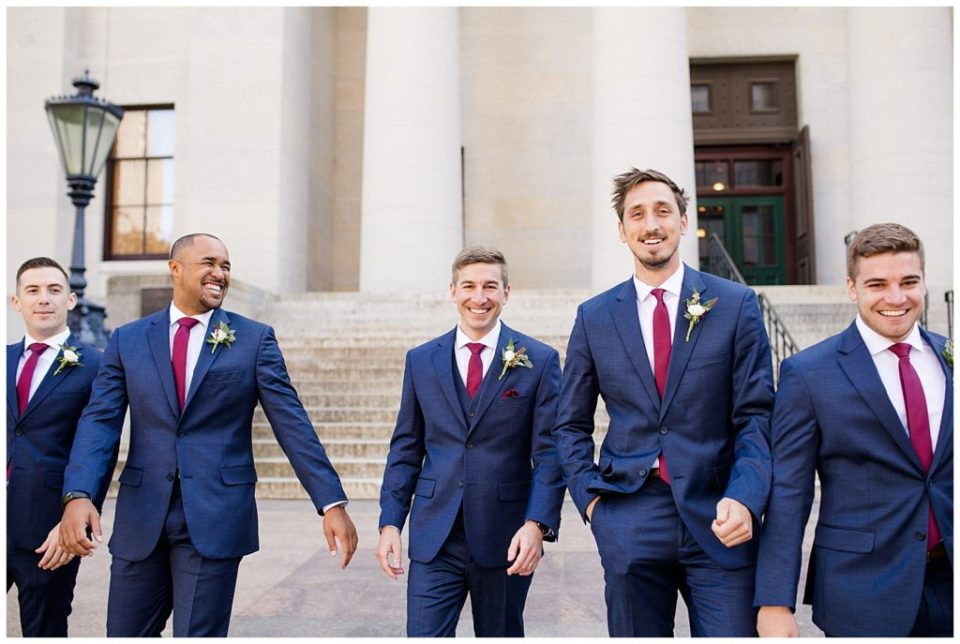 groom walking with groomsmen outside ohio statehouse