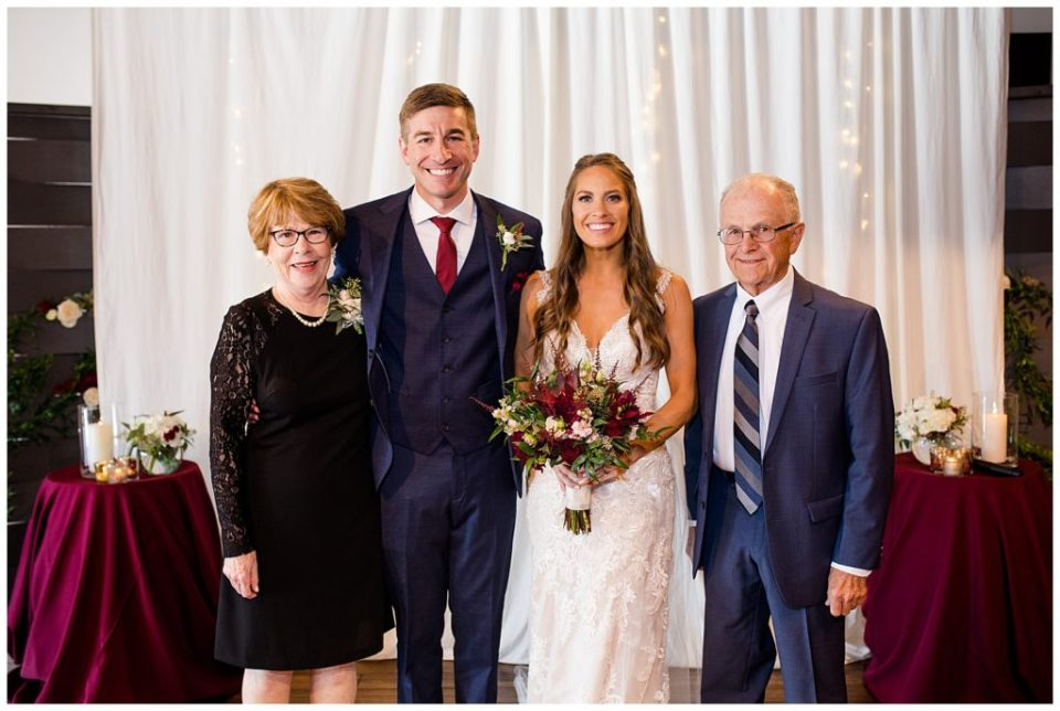 bride and groom with groom's grandparents at copius