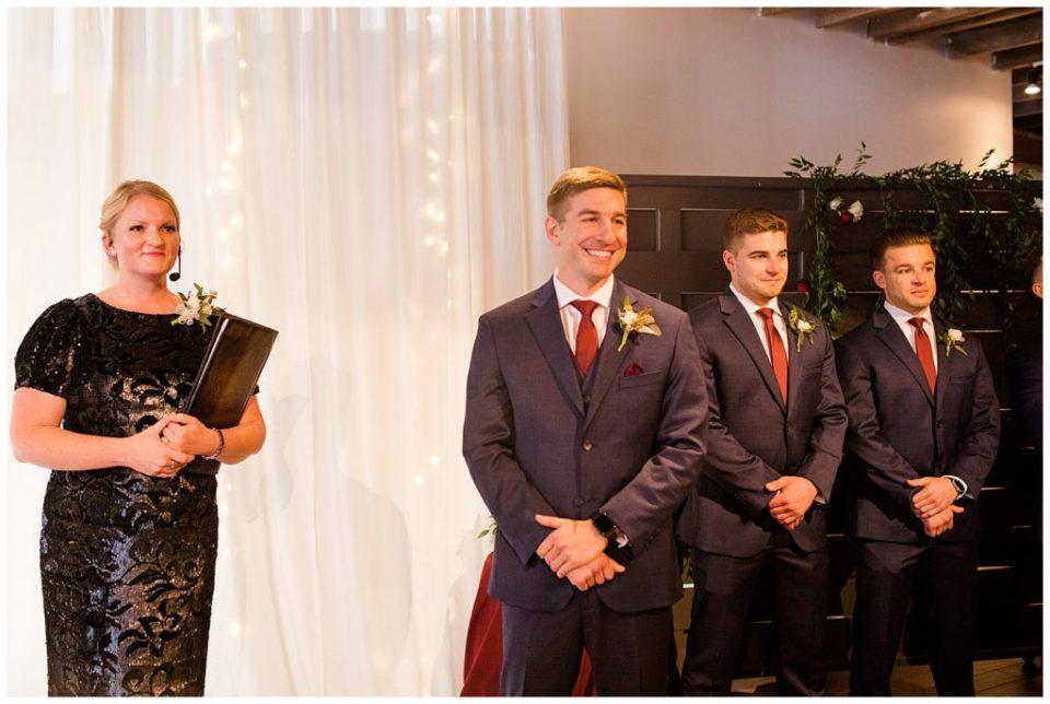 groom sees bride walking down the aisle at copius