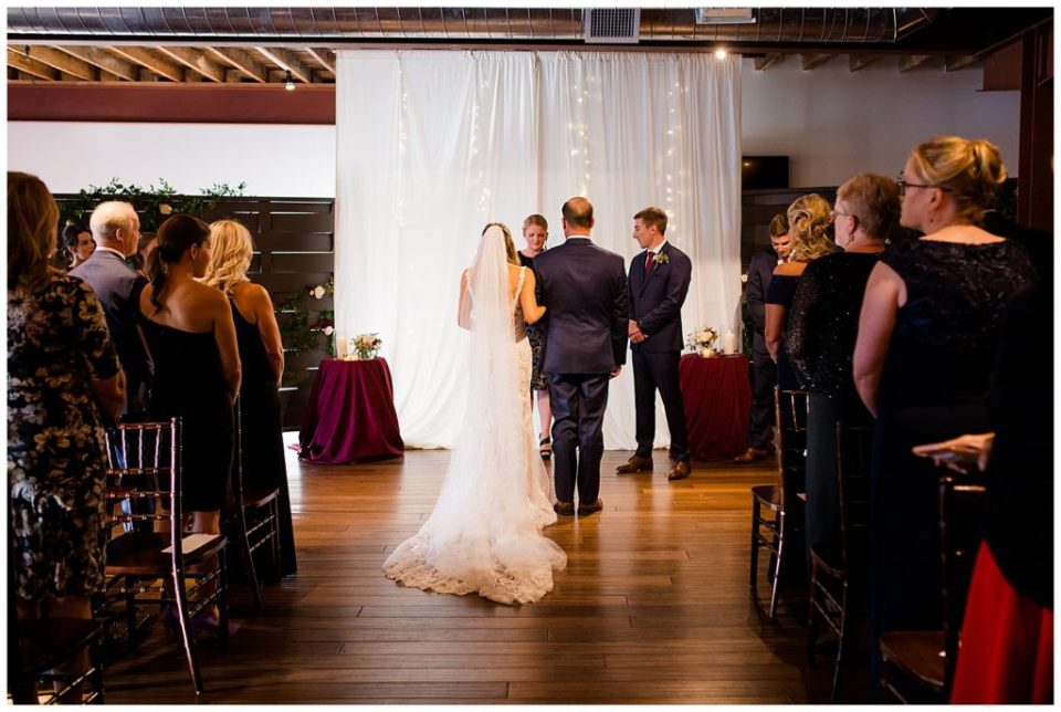 bride and father standing at altar at copius