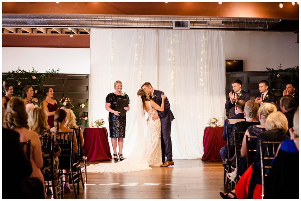 bride and groom share first kiss after being pronounced husband and wife at copius