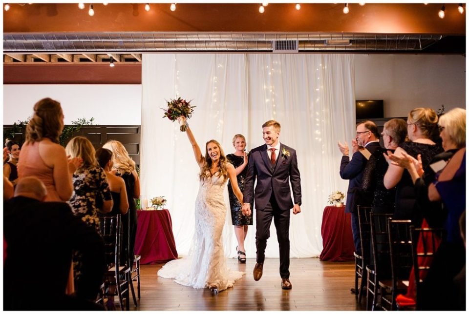 bride tossing bouquet in air after wedding ceremony at copius