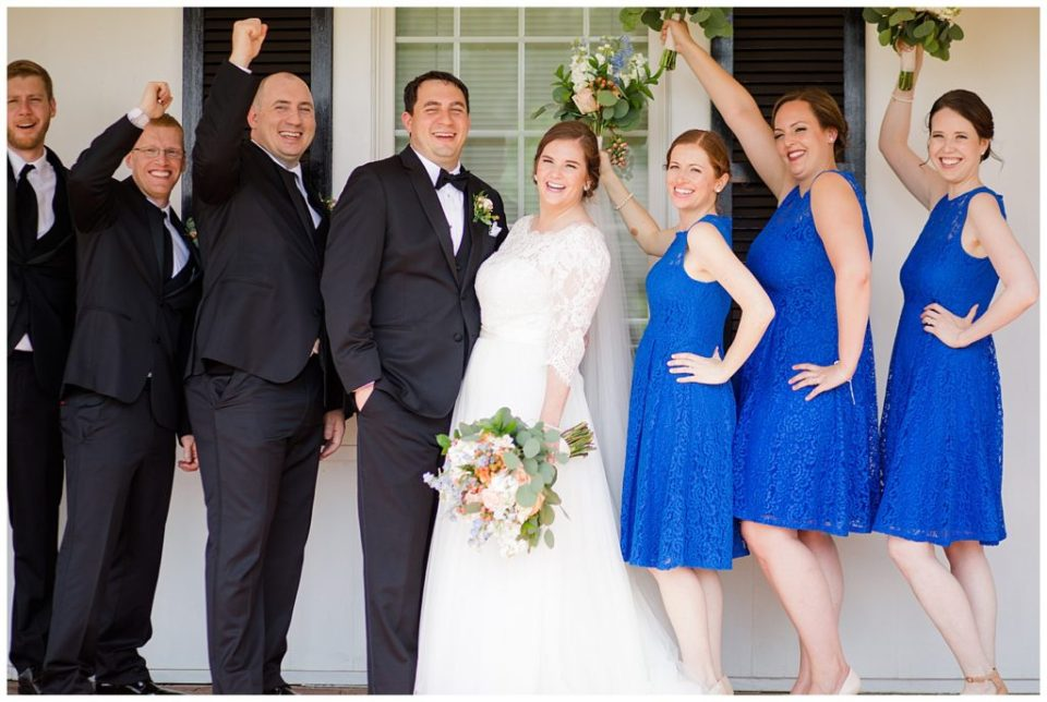 A photograph of the bride and groom with their wedding party lined up and laughing together at a Nationwide Hotel and Conference Center wedding by Columbus OH wedding photographer, Alayna Parker Photography
