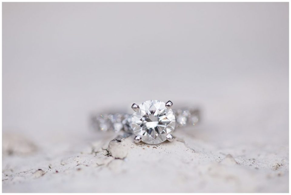 An image of a closeup of a diamond engagement ring sparkling brightly at Brookside Golf & Country Club by Columbus Ohio engagement photographer, Alayna Parker Photography