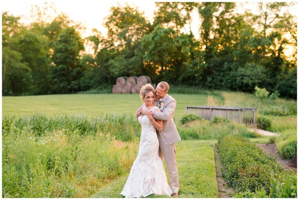 bride and groom during golden hour at jorgensen farms