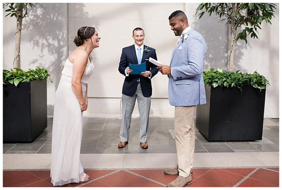 A picture of a groom reading his vows to his bride as they stand with the preacher at their wedding ceremony by Alayna Parker Photography - Columbus OH wedding photographer