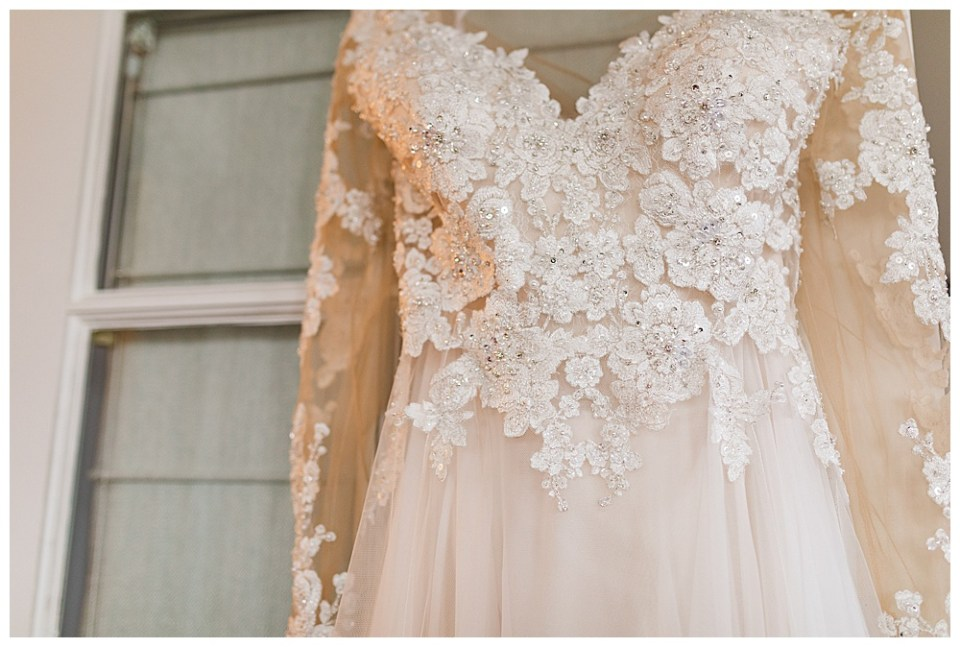 front of a wedding dress