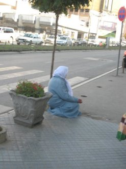 Woman begging on the street