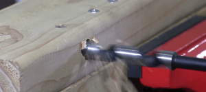 Drilling through a deck screw