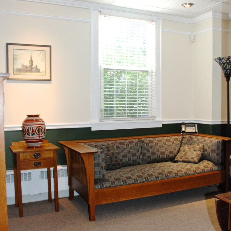 Consult room with couch, window, bright sunlight