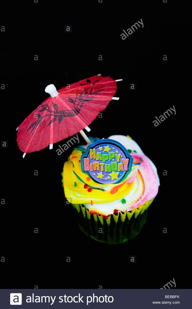 Birthday Cake Drink Close Up Of A Birthday Cake With A Drink Umbrella Stock Photo