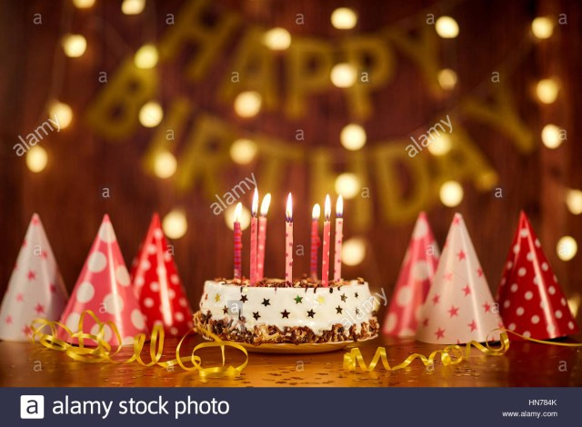 Birthday Cake Images With Candles Happy Birthday Cake With Candles On The Background Of Garlands A