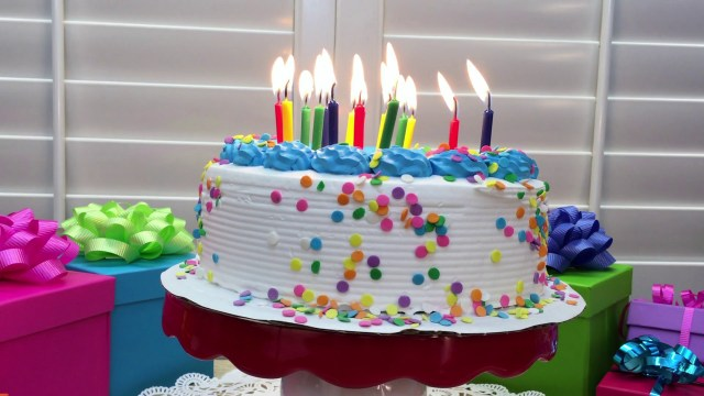 Birthday Cakes With Candles 4k Video Of A White Birthday Cake With Blue Icing Trim Candy
