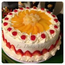 Tres Leches Birthday Cake La Dulce Vida Tres Leches Cake Decorated With Peaches Strawberries