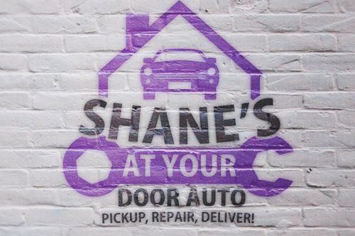 Shane's At your door auto logo created by The Alberta Writer
