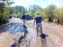The road into Riverbend Saturday 06/22 - BIll leading the way through the muck