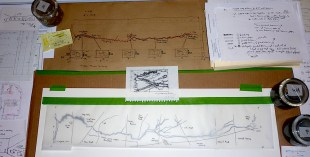 Detail of Table showing design changes of wall map and installation over 3 years