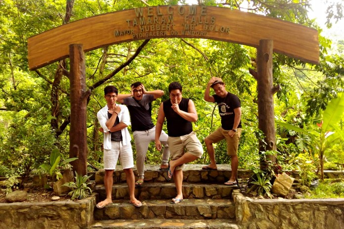 Posing at Tamaraw Falls' marker.