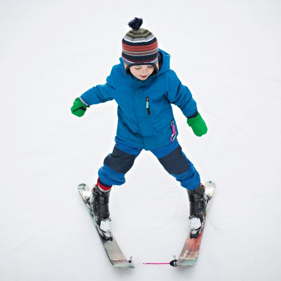little kid skiing pizza pie shape