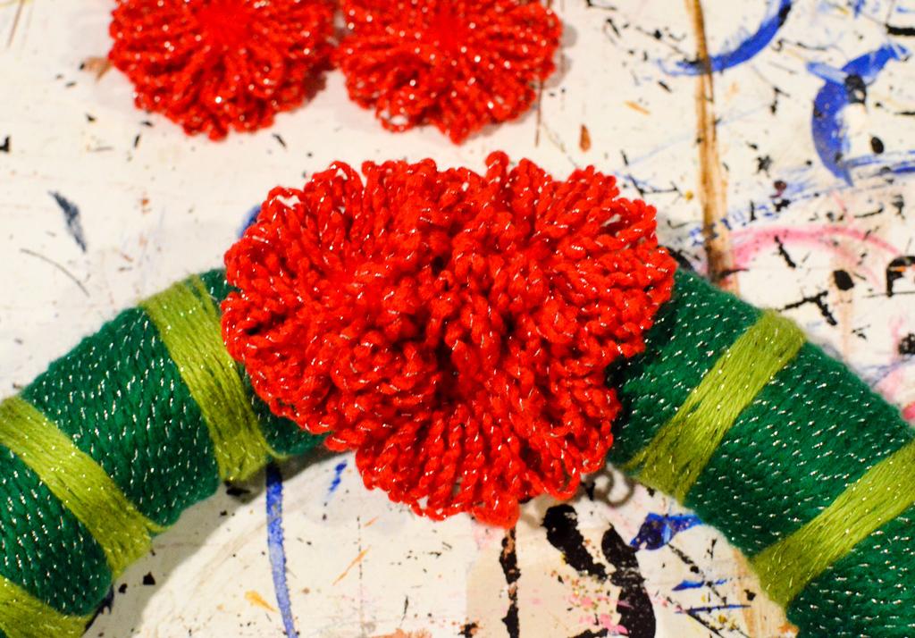 attach yarn flowers