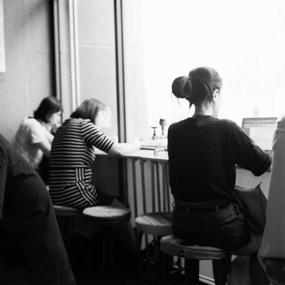 Cafe culture - Shot on Ilford Delta 400 Professional at EI 1600. Black and white negative in 120 format shot as 6x6. Push processed two stops.