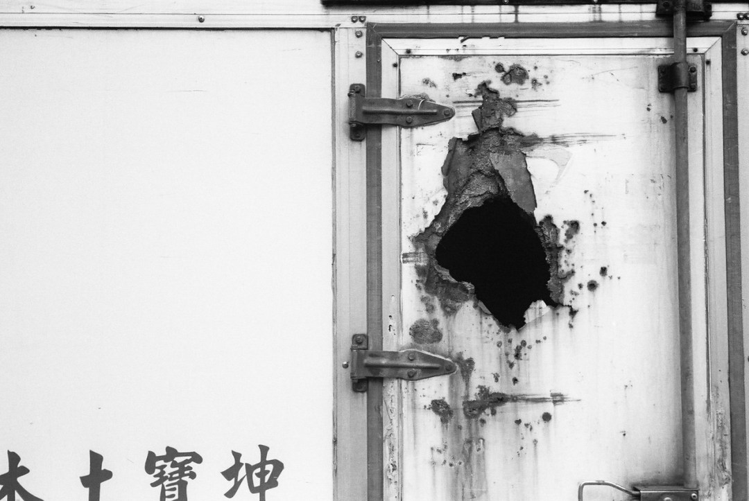Containment breach - Kodak Tri-X 400 shot at EI 1600. Black and white negative film in 35mm format. Push processed 2-stops.