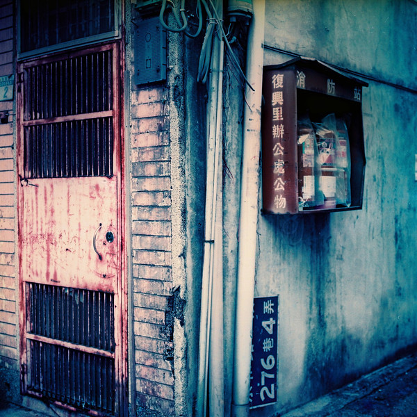 Cornered - LomoChrome Purple XR 100-400 shot at EI 200. Color negative film in 120 format shot as 6x6.
