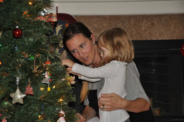 Helping Momma decorate the tree.