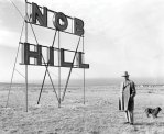 Photo of Colonel D. K. B. Sellers and Nob Hill sign.