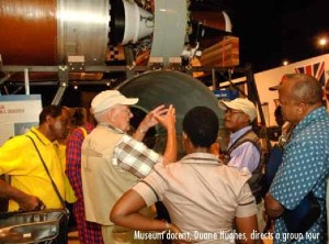 Photo of Duane Hughes conducting tour at the National Museum of Nuclear Science and History