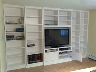 Built-in white lacquer wall unit, adjustable shelving (door open)