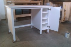 Desk with concealed adjustable shelving