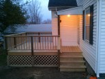 Small pressure treated deck in South Portland - view from the side